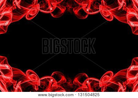 abstract frame from movement of red smoke on black background for graphic design with copy space