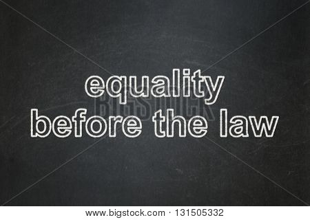 Political concept: text Equality Before The Law on Black chalkboard background