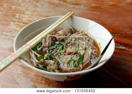 Rice vermicelli noodle with pork in the bowl