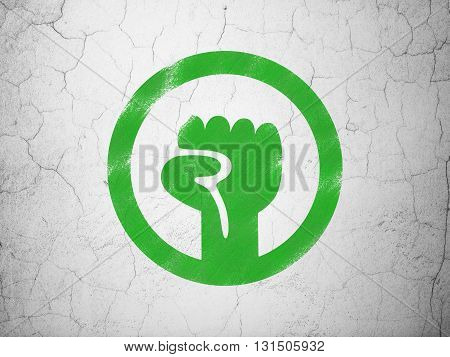 Political concept: Green Uprising on textured concrete wall background