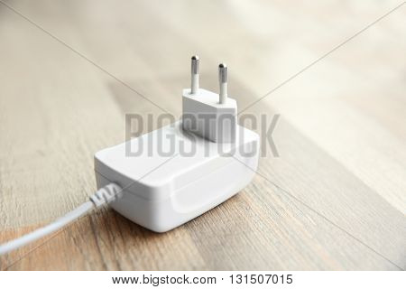 Power plug on wooden floor