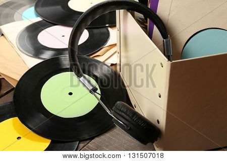 Vinyl records and headphones on table
