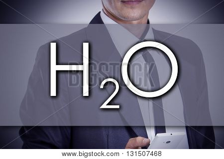 H2O - Water Molecule - Young Businessman With Text - Business Concept