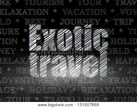 Travel concept: Glowing text Exotic Travel in grunge dark room with Dirty Floor, black background with  Tag Cloud
