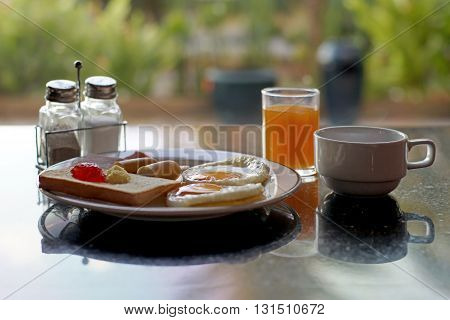 Breakfast Meal With Orange Juice And Coffee
