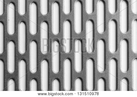the silver metal plate with the holesmetal plate black and white scene