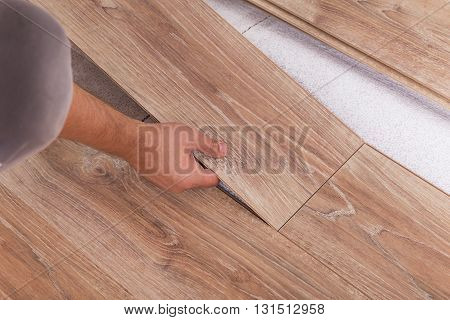 Installing Laminate Flooring. Carpenter Lining Parquet Boards To