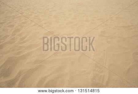 Sand on the beach, waves of sand