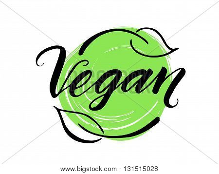 Vegan hand drawn brush lettering. Vegan word, label with leaves and green background.