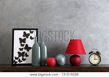 Colorful interior decorations on grey wall background
