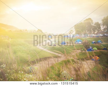 Abstract blur travel background with natural mountains and camping tent