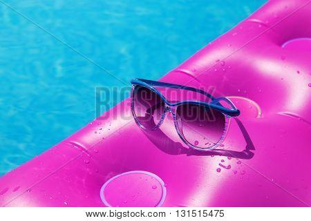 Sunglasses Pink Air Mattress Swimming Pool. Tropical Concept