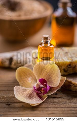 Spa essential oil for aromatherapy treatment on wooden background