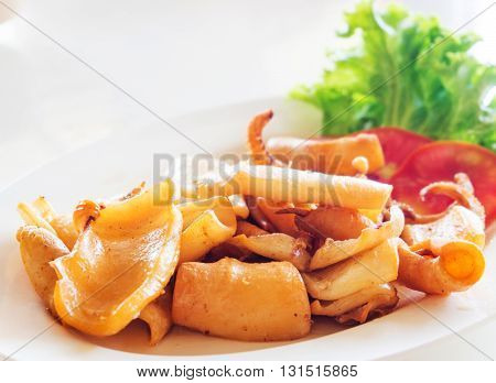 Fried dry Squid seafood dish in restaurant