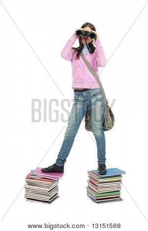 Portrait of a scoolgirl standing on a stack of books and looking to her binocular.