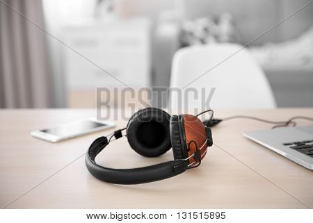 Stylish headphones and gadgets on table