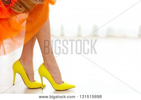 Woman wearing yellow high heels.
