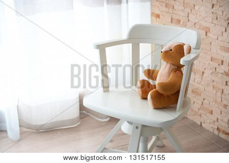 Kid's toy on the chair indoors
