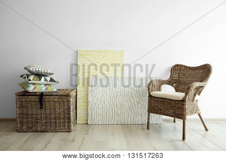 Wicker furniture on light wall background