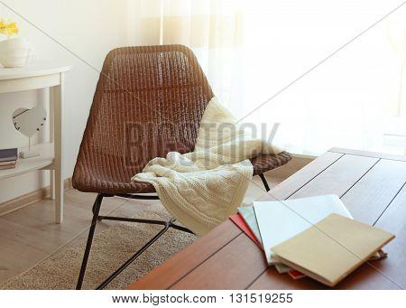Modern living room interior. Chair beside wooden table.