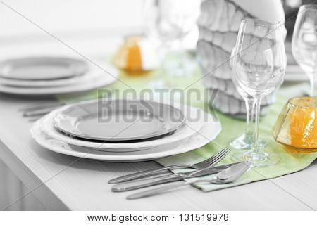 Table served with dishes and silver flatware