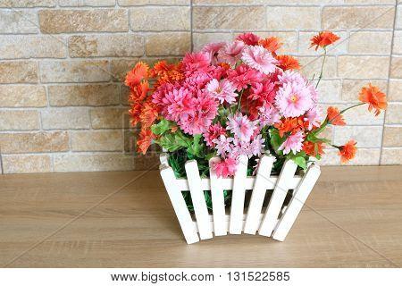 Beautiful flowerpot on the wood floor in room