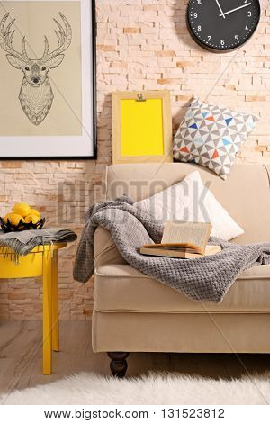 Beige sofa in modern room interior