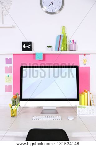 Stylish workplace with computer and interior decorations