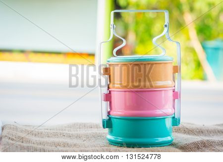 Colorful Food Carrier On Sack Table And Blur Background