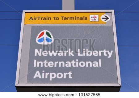 Newark, New Jersey - April 25, 2016: Newark Liberty International Airport and train and terminal sign, Newark, New Jersey, USA