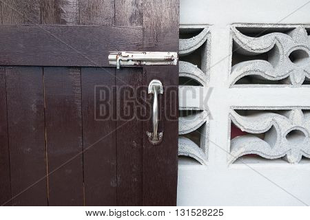 latch on a wooden door in home