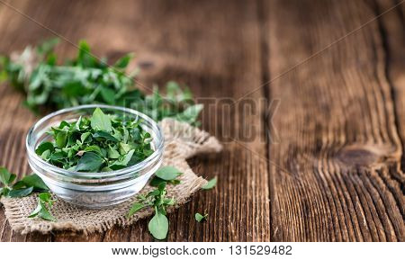 Wooden Table With Fresh Menthol Leaves