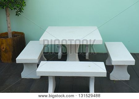 Decorated stone garden furniture table and chairs