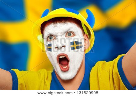 Swedish fans at the stadium. Football, soccer fan