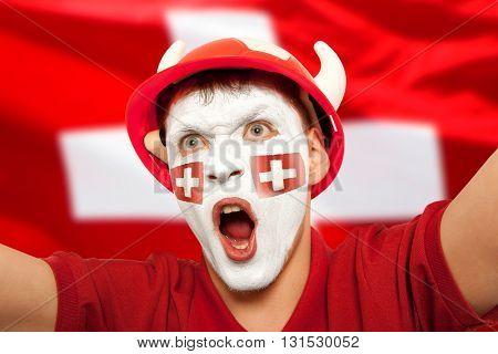 Swiss fans at the stadium. Football, soccer fan