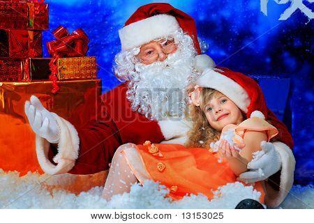 Christmas theme: Santa  gifts, snowy design, child.
