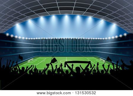 Excited crowd of people at a soccer stadium. Football stadium. Soccer arena.