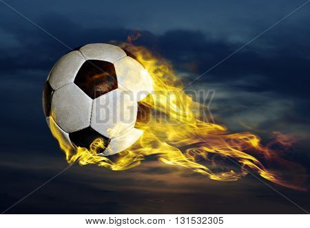 flying fiery soccer ball in sky