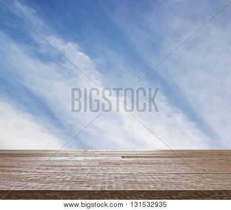 Wooden table top on blue sky with cloud pattern, Can be use for display or montage you product