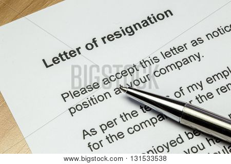 Letter of resignation closeup with silver pen