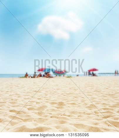sand on beach closeup and sun in blue  sky. soft focus on bottom of picture