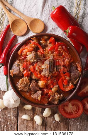 Lamb Slow Stewed With Onion, Tomato And Pepper Closeup. Vertical Top View