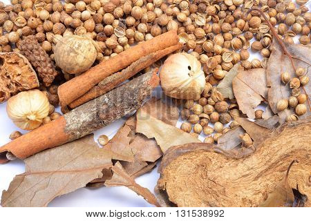 Nutmeg and other spices isolated on white