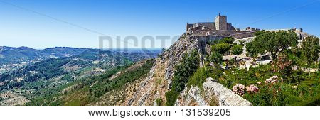 Marvao, Portugal. July 24, 2015: The Marvao Castle located on top of a cliff with a view over the Alto Alentejo landscape. Candidate to World Heritage Site by UNESCO.