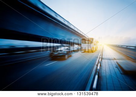 motion blurred traffic on the yangtse river bridge,chongqing china.