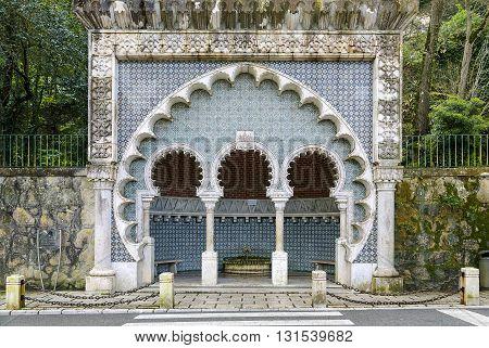 Sintra Portugal - March 20 2016: Beautiful moorish fountain in Volta Duche the ancient city of Sintra Portugal