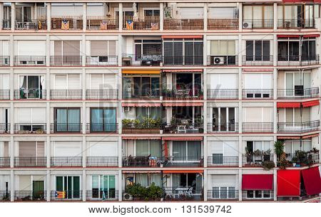 Big building with lots of apartments, outdoor view. Many apartments balconies in one house. Building in Barcelona.