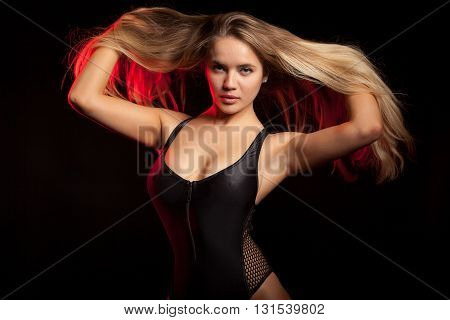 Sensual Blonde Blowing Her Hairs With Red Light Behind