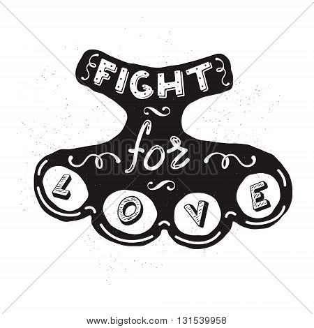 Silhouette of brass knuckles with the words Fight for love. design element in vector