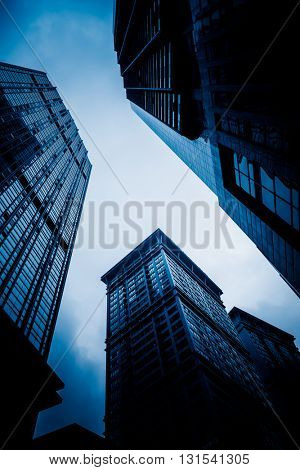 low angle view of skyscrapers of chongqing city,china,blue toned image.